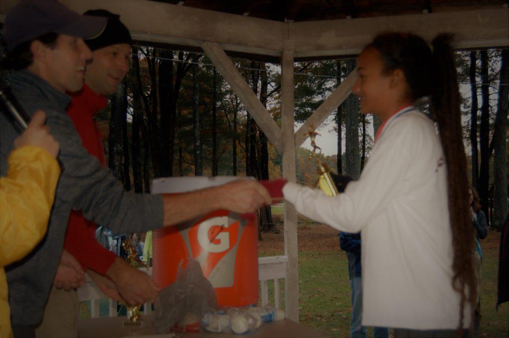 Runner receiving award